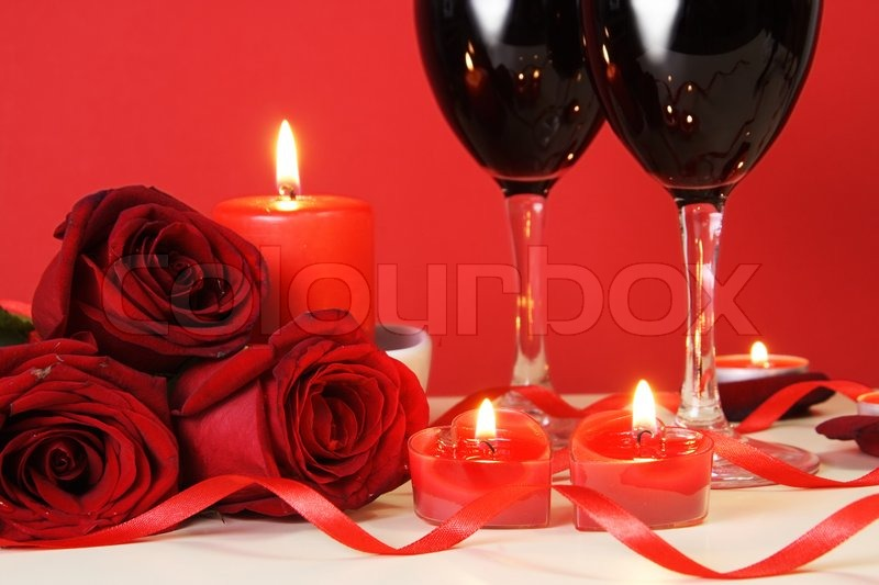 Stock image of 'Heart Candles, Red Roses and Wine Romantic Meal Concept'