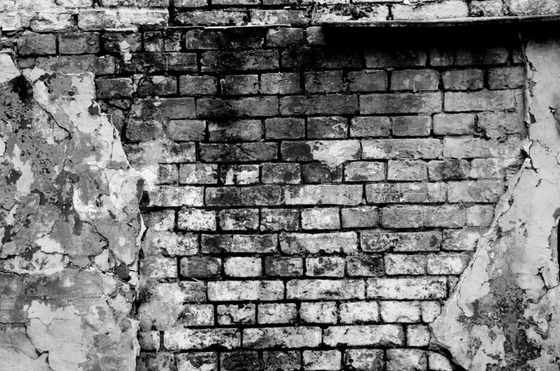 Old Brick Wall Forming A Frame In Black And White