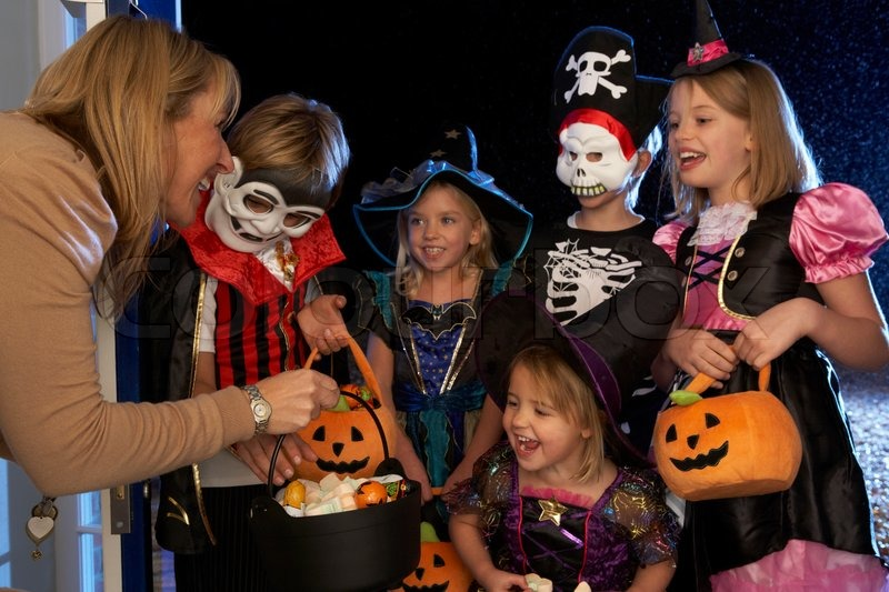 Happy Halloween party with children trick or treating, stock photo