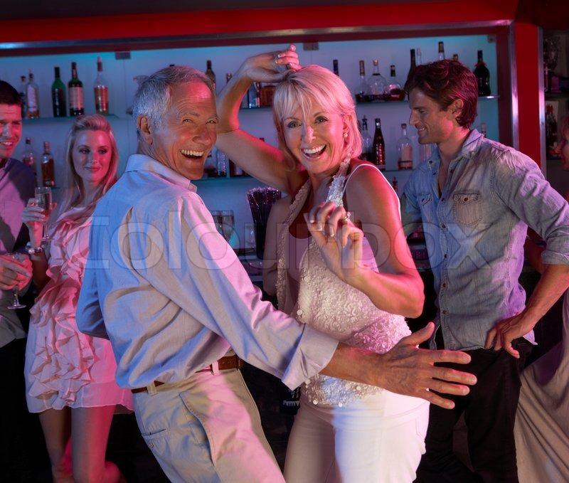 Senior Couple Having Fun In Busy Bar  Stock Photo  Colourbox-7179