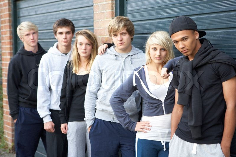 Group of teenagers hanging out together outside stock for Hanging groups of pictures