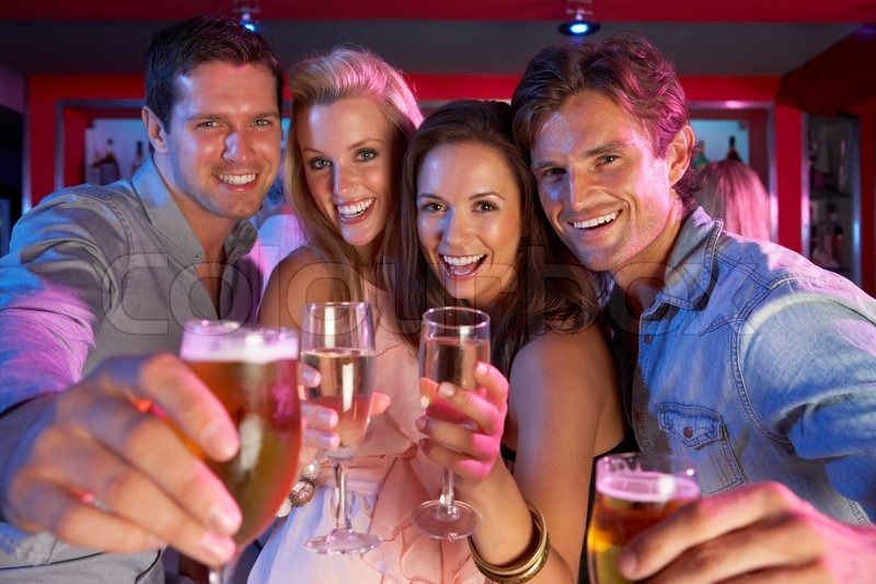 Group Of Young People Having Fun In Busy Bar, stock photo
