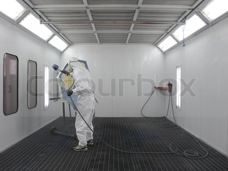 The Image Of Painter Works In A Spray Booth Stock Photo