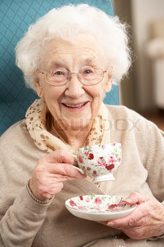 Senior Woman Enjoying Cup Of Tea At Home Stock Photo