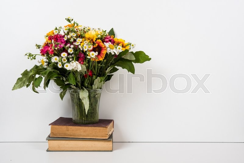 Interior home decor with flowers and books, simple summer decor with copyspace, stock photo