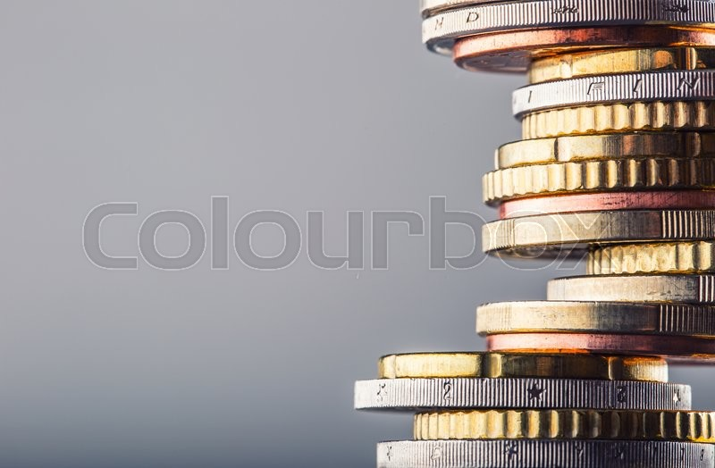 Euro coins. Euro money. Euro currency.Coins stacked on each other in different positions. Money concept, stock photo