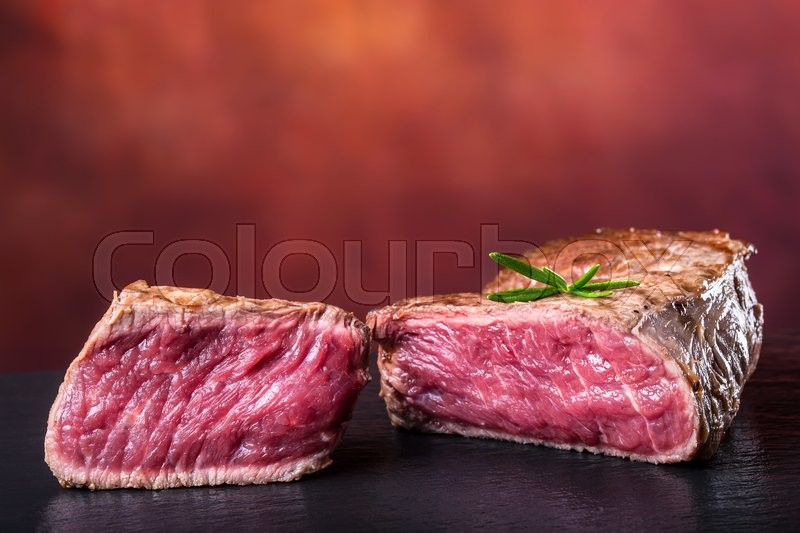 Grill beef steak. Portions thick beef juicy sirloin steaks on grill teflon pan or granite board, stock photo