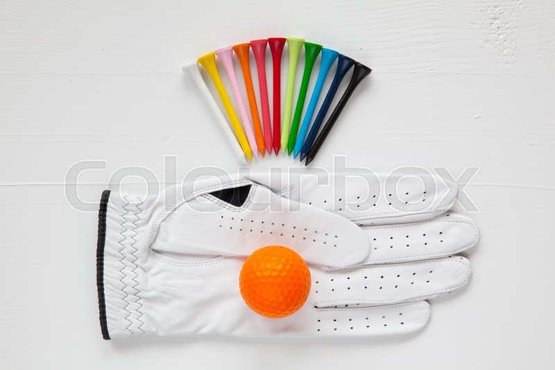Different golf equipments on the white table, stock photo
