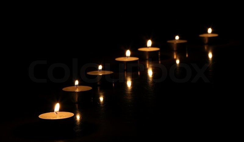 Candle Background Candles on a Black Background