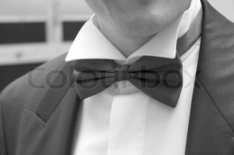 Man in black suit with bow tie, stock photo