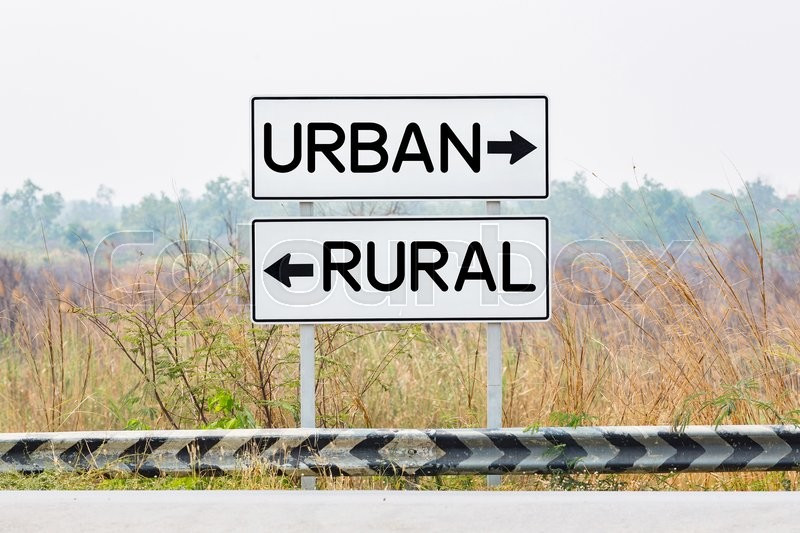 Road sign boards with urban and rural text, opposite wording concept, stock photo