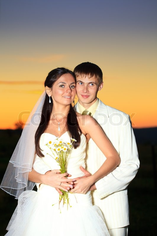 Wedding Couple Dansing In Mountain Hill On Sunset Stock Photo