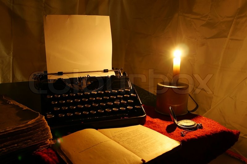 Candle, old typewriter and old book | Stock Photo | Colourbox