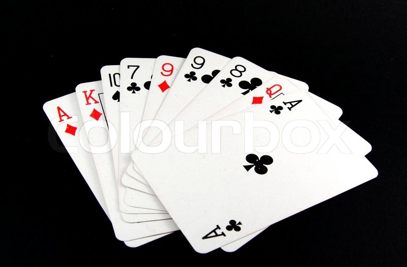 Playing cards on black background   Stock Photo   Colourbox