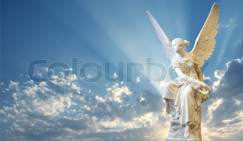Beautiful angel in heaven with divine rays of light, stock photo