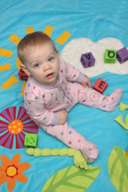 A Small Baby Girl Playing By Herself  Stock Photo  Colourbox-6826