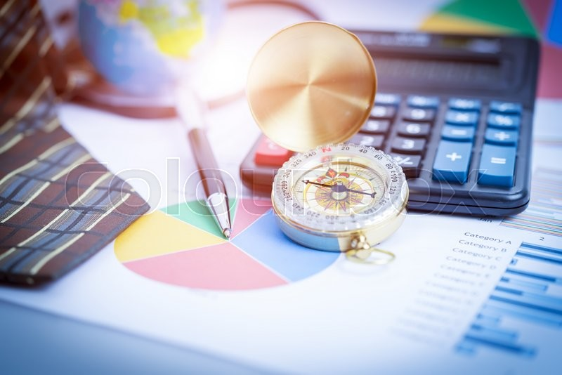 Business analyzing investment charts with laptop, calculator, pen, compass. Accounting. Vintage filtered, stock photo