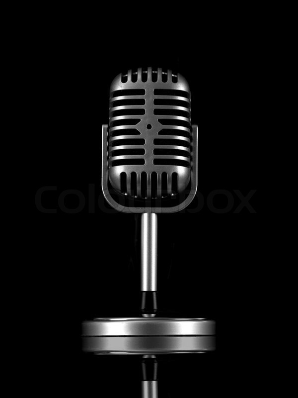 A Microphone Isolated Against A Black Background Stock