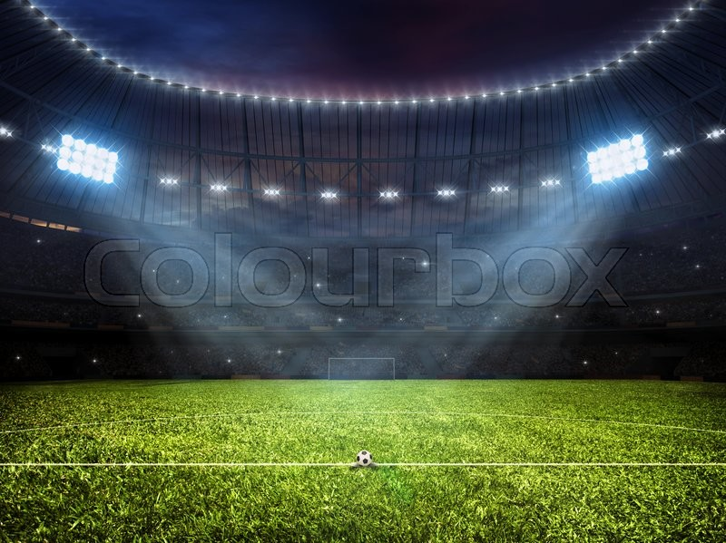 Sport concept background - soccer footbal stadium with floodlights. Grass football pitch with mark up and soccer goal with net, stock photo