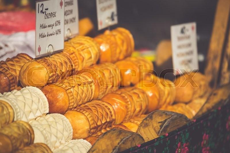 Traditional polish smoked cheese oscypek on outdoor market in Zakopane, stock photo