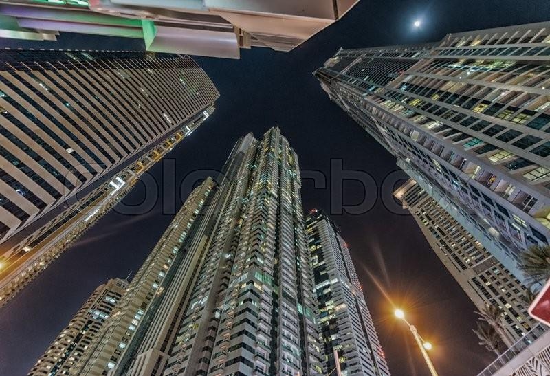 Dubai marina buildings at twilight, UAE, stock photo