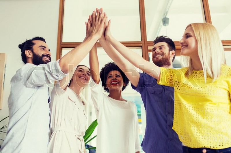 Business, startup, gesture, people and teamwork concept - happy creative team making high five in office, stock photo