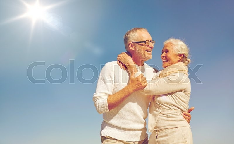 Family, love and people concept - happy senior couple hugging outdoors, stock photo