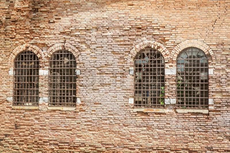 Orange stone wall with windows in Venice, stock photo