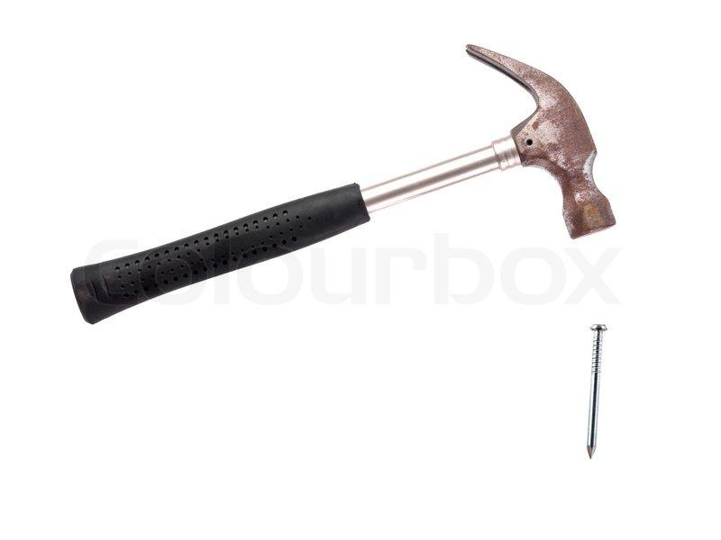 ein metall hammer und einen nagel vor einem wei en. Black Bedroom Furniture Sets. Home Design Ideas