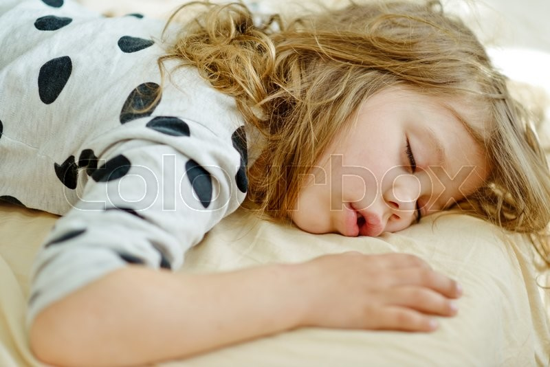 Sweet dreams of the toddler sweet girl , stock photo