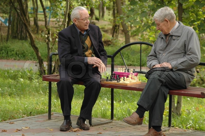 Two Men Playing Chess In The Park Stock Photo Colourbox