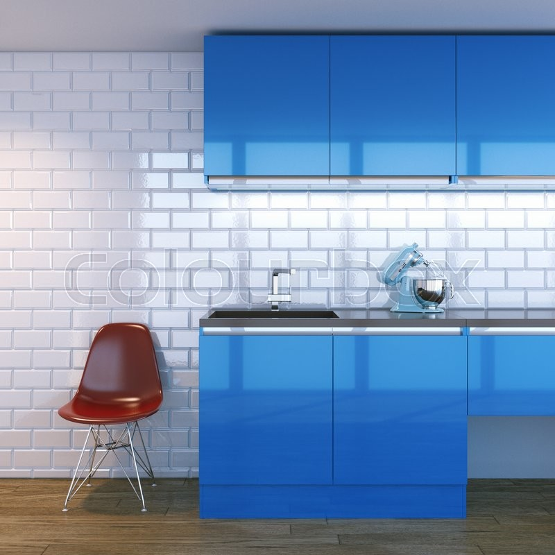 New contemporary blue kitchen furniture in white interior with classic tiles, stock photo