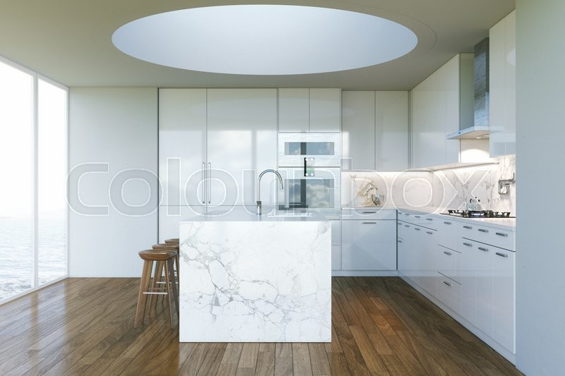 White Contemporary Kitchen in new Interior with beautiful view to ocean beach, stock photo