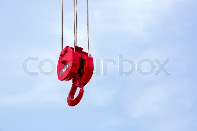 Metal hook of a crane against the sky, stock photo