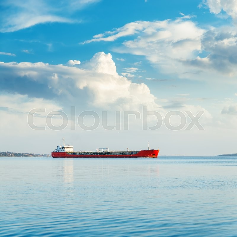 One big ship in river and blue sky with clouds, stock photo