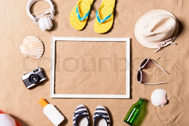 Summer vacation composition with picture frame, pair of yellow flip ...