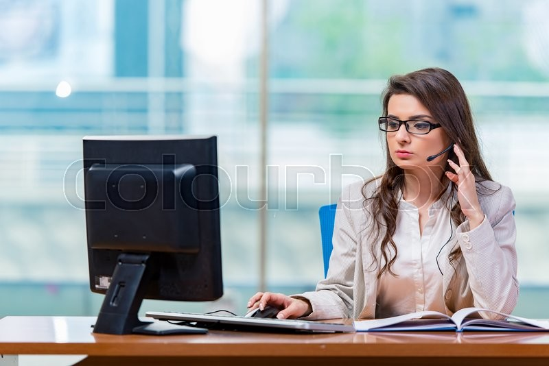 Call center operator working in the office, stock photo