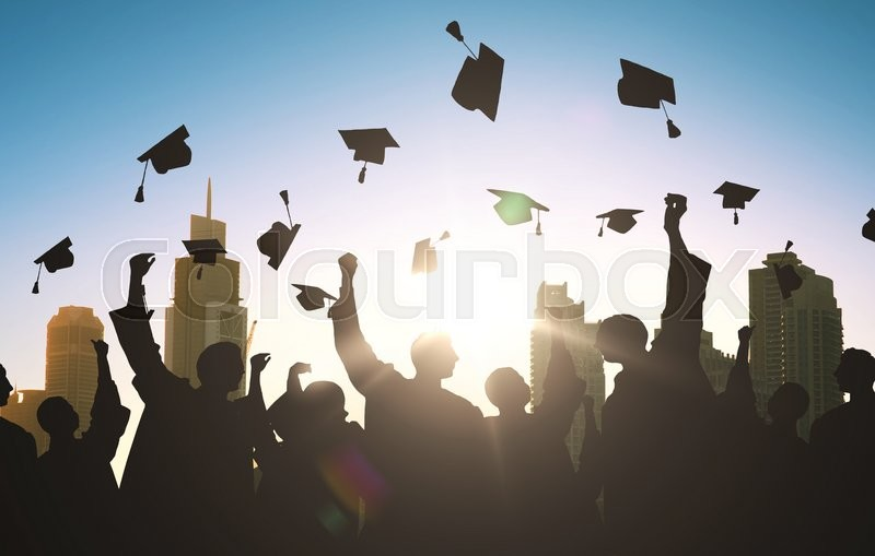 Education, graduation and people concept - silhouettes of many happy students in gowns throwing mortarboards in air, stock photo