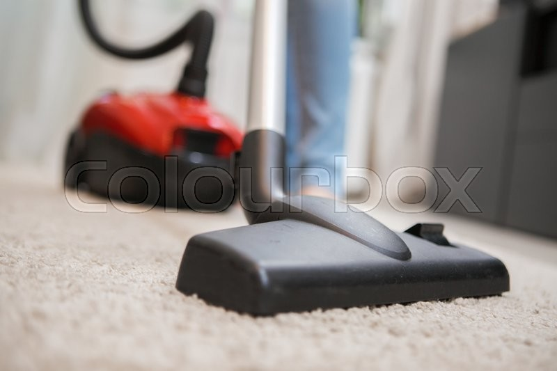 Black vacuum cleaner brush closeup. Carpet cleaning indoor, stock photo