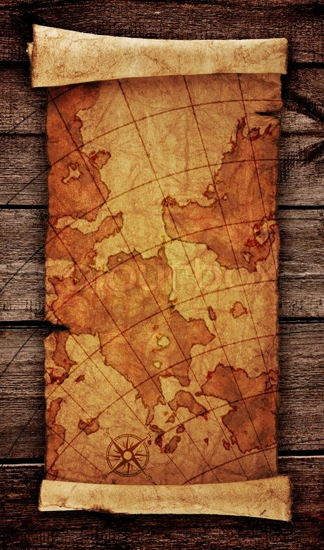 ancient scroll map on the old wooden background stock