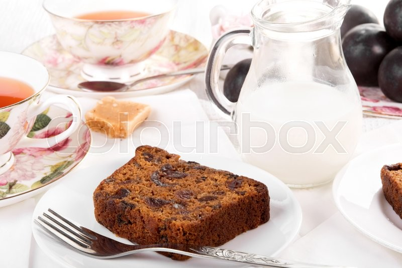 Tea served with traditional British fruit cake, stock photo