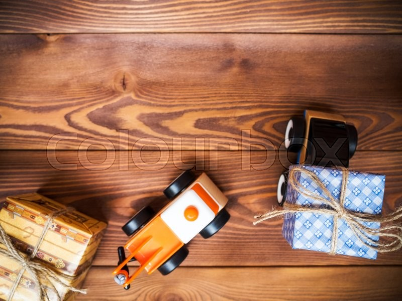 Gift box and toy machinery. Gift delivery service concept. Shallow focus, stock photo