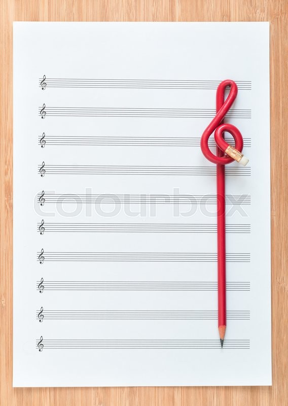 blank sheet music end a red pencil in the shape of treble clef  composing concept