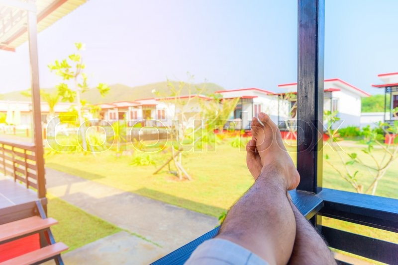 Man S Feet Relax In Hotel Stock Photo