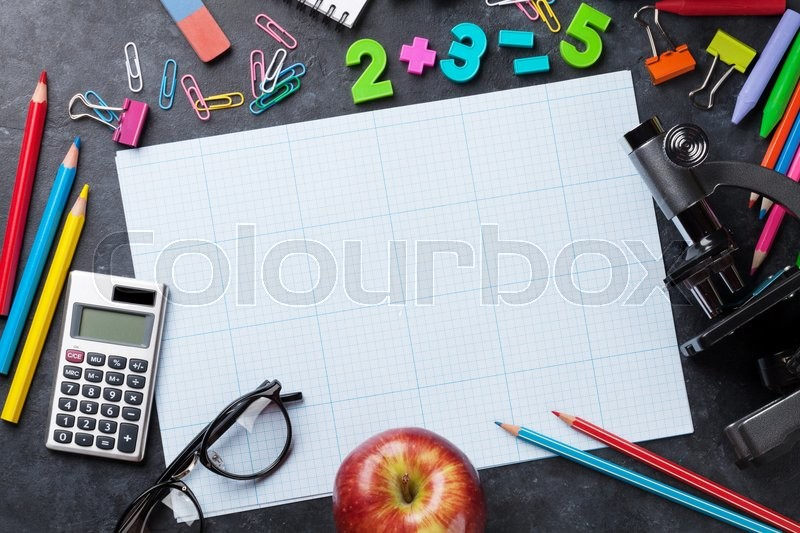 School and office supplies in front of chalk board. Back to school concept with copy space, stock photo