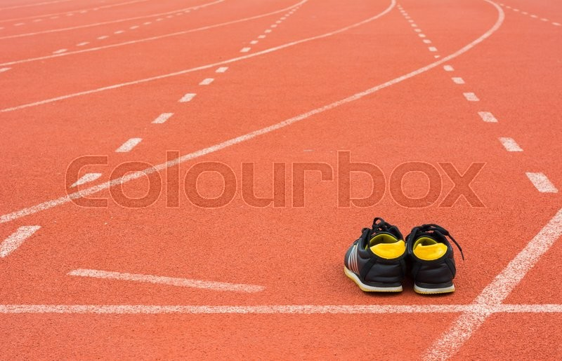 Sport shoes on running track background, stock photo
