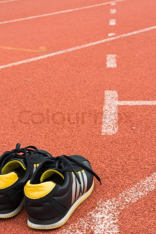 sport shoes on running track background stock photo colourbox