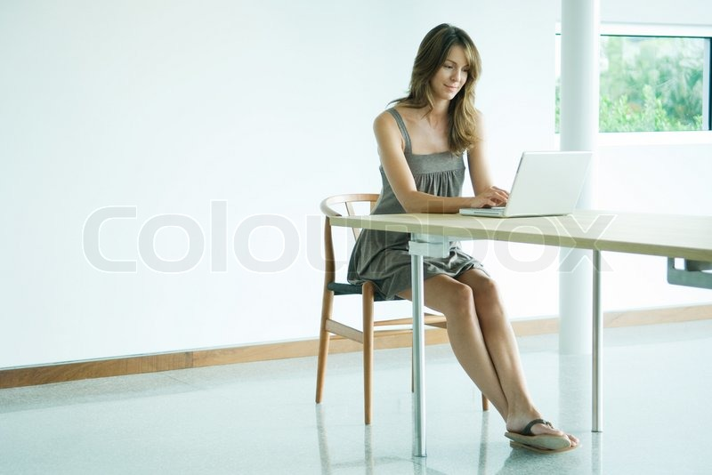 Stock Image Of U0027©Eric Audras/AltoPress/Maxppp ; Woman Sitting At Table