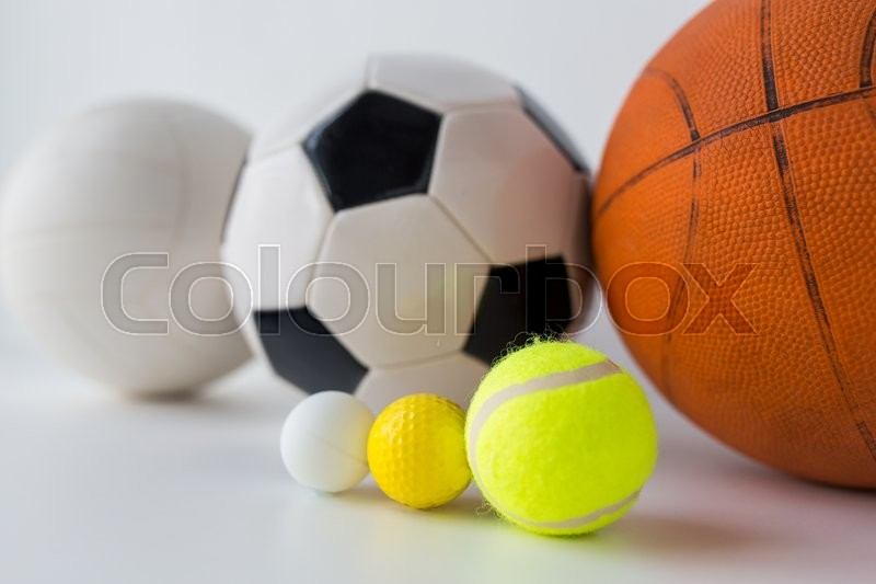 Sport, fitness, game, sports equipment and objects concept - close up of different sports balls set, stock photo