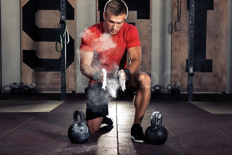 Young athlete getting ready for crossfit training, stock photo
